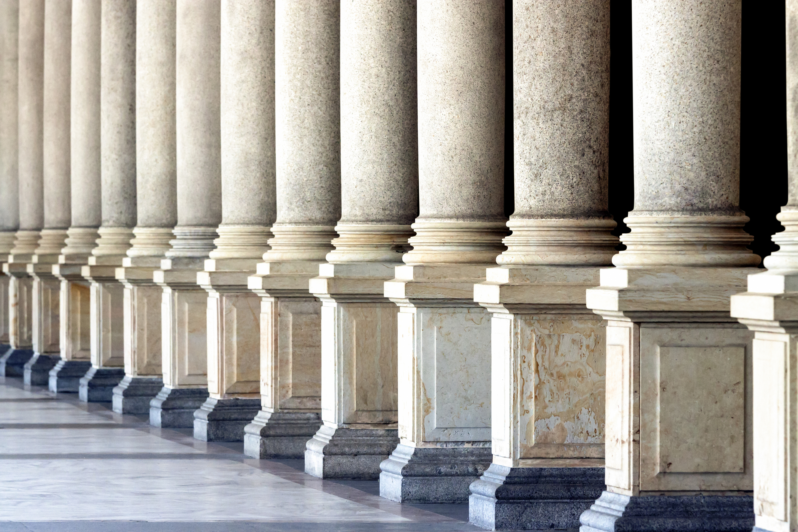 Row of classical columns, full frame horizontal composition, copy space